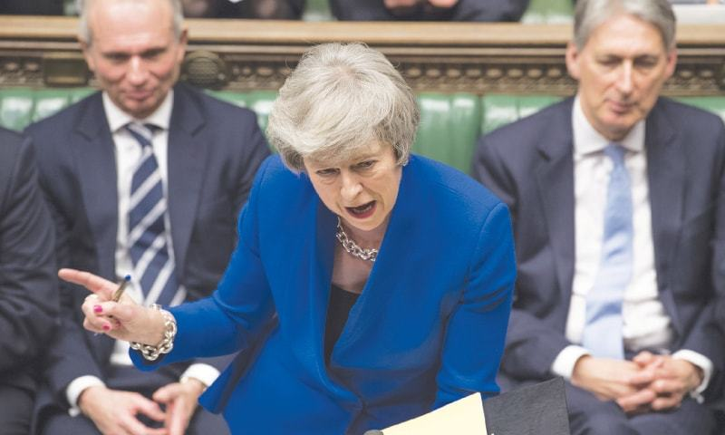 PRIME Minister Theresa May speaks during a debate before a no-confidence vote in the House of Commons on Wednesday.—AP