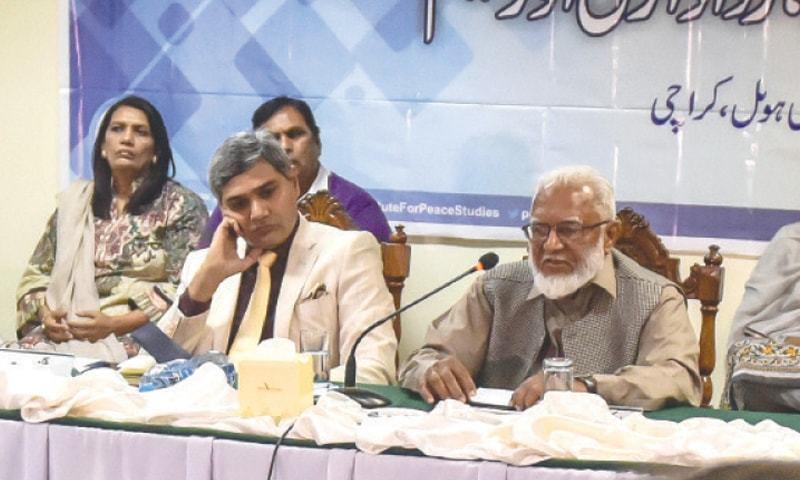 DR Khalid Masud speaks at the seminar.—White Star