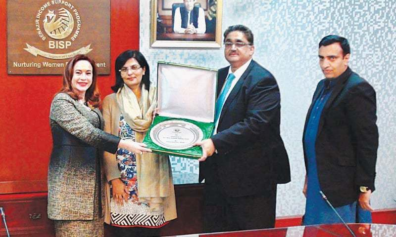 Benazir Income Support Programme chairperson Dr Sania Nishtar and BISP secretary Omar Hamid Khan present a memento to UN General Assembly president Maria Espinosa on Friday.—APP