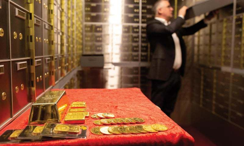 DUBLIN: Seamus Fahy, co-founder of Merrion vaults, removes a safety deposit box from a wall of boxes in Merrion vaults.