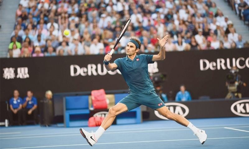 MELBOURNE: Switzerland's Roger Federer hits a return against Stefanos Tsitsipas of Greece during their match at the Australian Open on Sunday.—AFP
