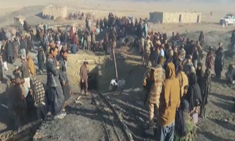 People gather outside the landmine where an explosion took place on Monday morning. — DawnNewsTV