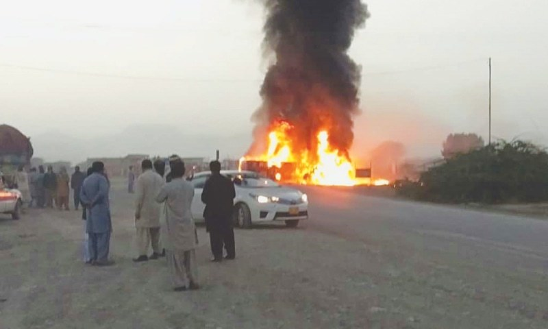 A PLUME of smoke billows from burning vehicles as people gather at the site of the accident on Monday.—White Star