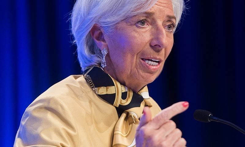 IMF's Christine Lagarde says risks rising as world's economy grows more slowly than expected. ─ File photo