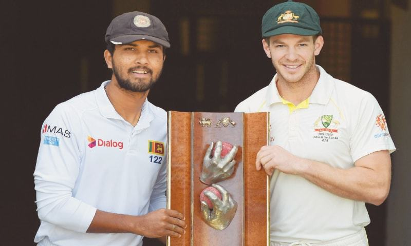 BRISBANE: Sri Lankan captain Dinesh Chandimal (L) and his Australian counterpart Tim Paine pose with the Warne-Murali Trophy at the Gabba on Wednesday.—AFP