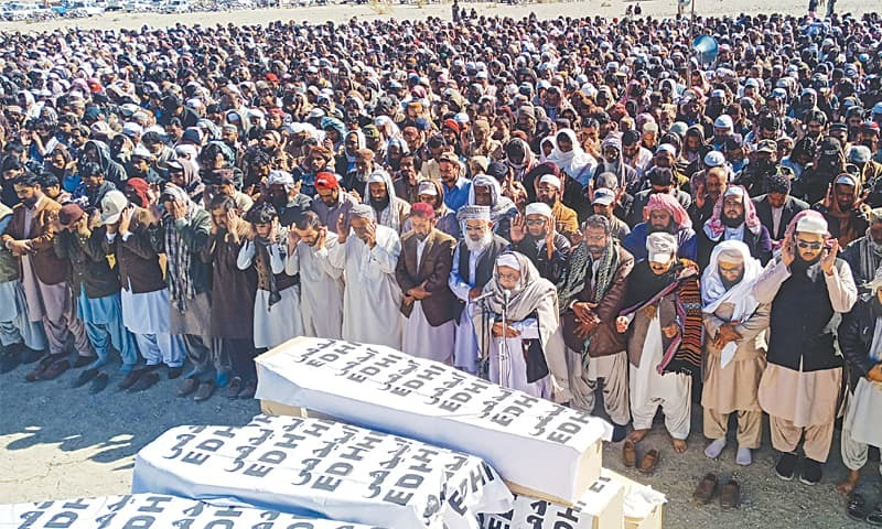 Panjgur: A large number of people attend the victims' funeral on Wednesday.—AFP