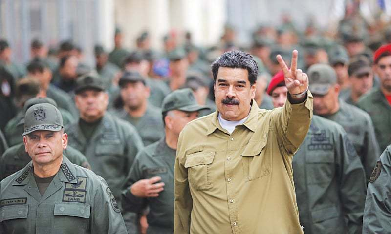 Caracas: Venezuela's President Nicolas Maduro flashing the V-sign during a military rally on Wednesday.—AFP