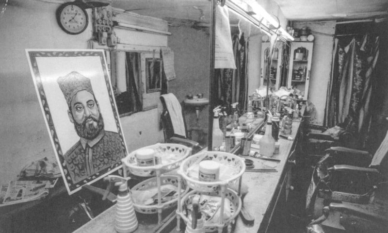 An image of Daagh Dehlvi pasted to a mirror in a Delhi barbershop. Daagh was born in Chandni Chowk, one of the oldest markets in the city. Much of his life was spent in the cities of Delhi and Rampur. However, as patronage for poets in Delhi declined, he moved to Hyderabad at the age of 59 and died there 15 years later | Photo from the book