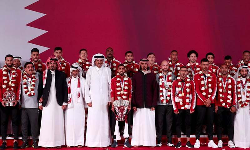 Qatar's Emir Tamim bin Hamad al-Thani (5th-L) welcomes the Qatari national football team at Doha airport as the players and staff come back from the United Arab Emirates with the trophy after winning the 2019 AFC Asian Cup football tournament. ─ AFP