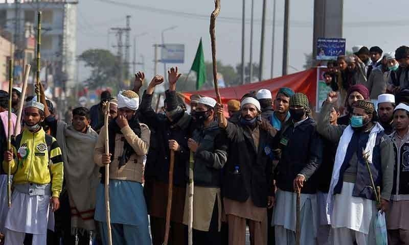 A file photo of TLP workers carrying batons and protesting on streets.