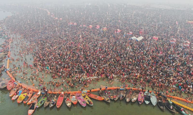 ALLAHABAD: An aerial shot of Hindu devotees taking a holy dip at Sangam during the Kumbh Mela on Monday.—AFP