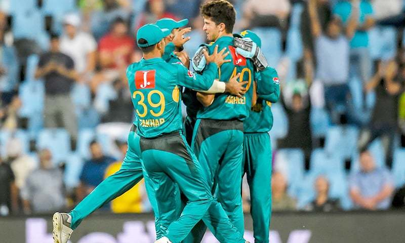 Pakistan's Mohammad Rizwan (L) celebrates with Pakistan's Shaheen Afridi after getting the wicket of South Africa's Reeza Hendricks during the 3rd T20I cricket match between South Africa and Pakistan at the SuperSport Park Stadium on February 6, 2019 in Pretoria. — AFP