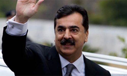 Former premier Yousuf Raza Gilani says he will challenge travel ban in court. — File photo