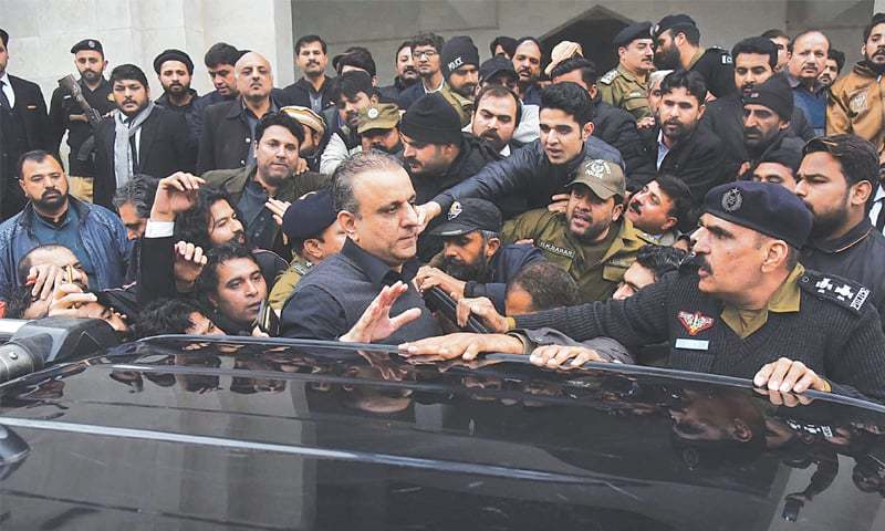 LAHORE: Aleem Khan coming out of the NAB court, which granted his eight-day physical remand on Thursday. The senior leader of the Pakistan Tehreek-i-Insaf was arrested on Wednesday for his 'involvement' in a number of corruption cases.—Online