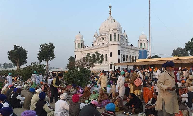 Sikh Pilgrims partake in Langar in front of Kartarpur Gurdwara Sahib after the groundbreaking ceremony of Kartarpur crossing in Nankana Sahib. — AFP