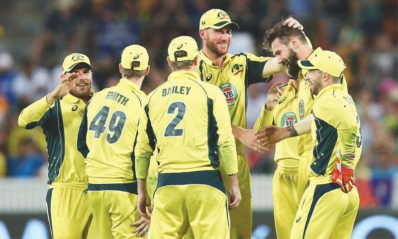 AUSTRALIAN paceman Kane Richardson (second R) is congratulated by team-mates after he took a wicket during the fourth One-day International against India at Manuka Oval on Wednesday. — AP