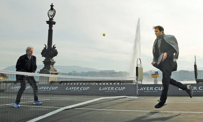 GENEVA: Switzerland's Roger Federer plays a return to Bjorn Borg of Sweden (L) during a tennis session to promote the Laver Cup on a temporary court on the banks of Lake Geneva on Friday.—Reuters