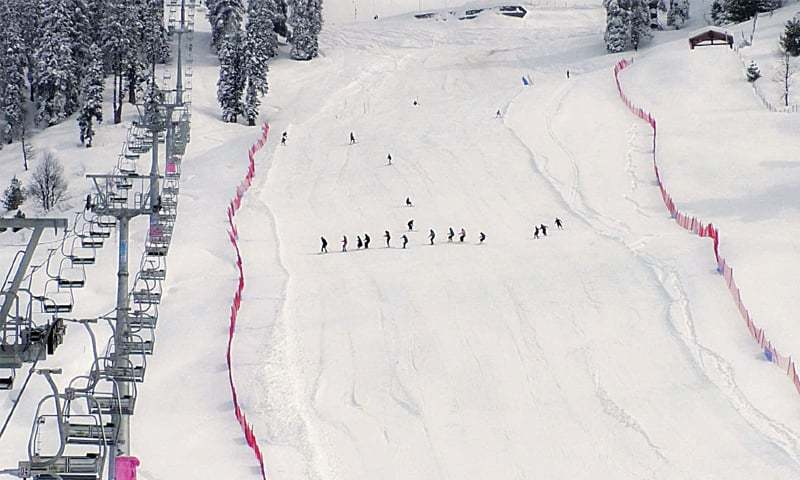 MALAM JABBA: Participants of the winter sports gala ski on a 9,000-foot-high slope in the picturesque valley on Friday.—Dawn