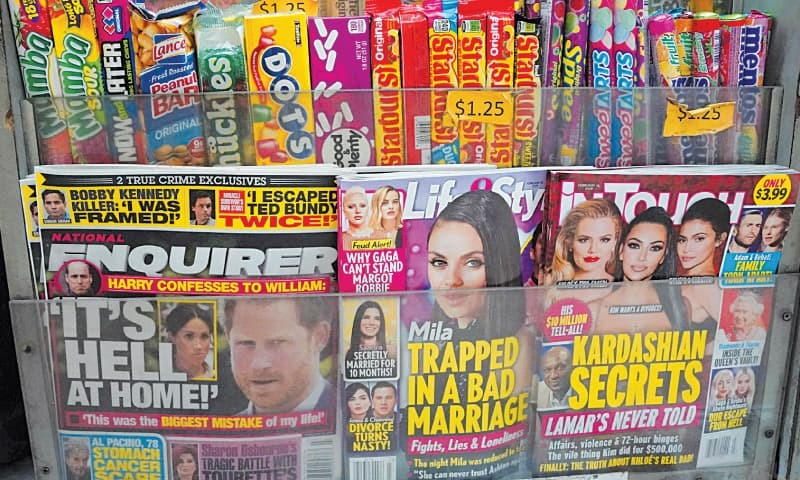 NEW YORK : A copy of the National Enquirer (left) is seen at a newspaper vendor's shop on Friday.—AFP