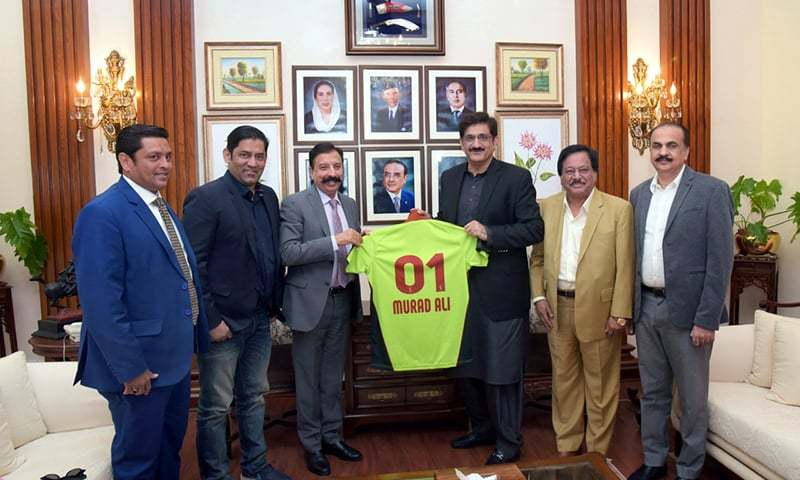 Chief Minister Murad Ali Shah being presented the official T-shirt of the Lahore Qalandars. —CM House