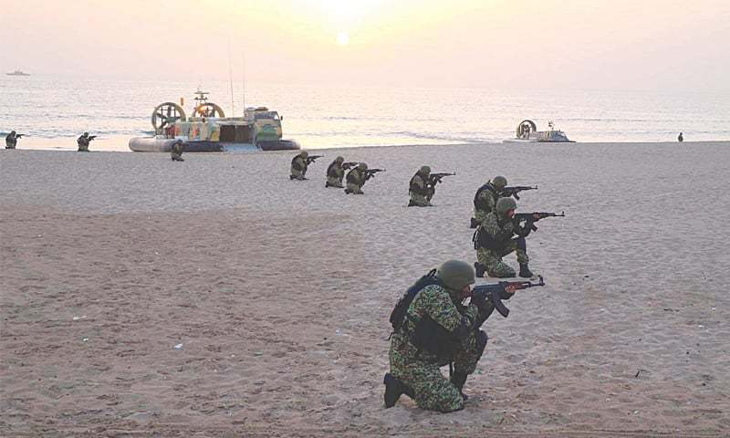 KARACHI: Personnel of the Special Services Group take part in a mock operation held in connection with the ongoing Aman-2019 Exercise.—Online