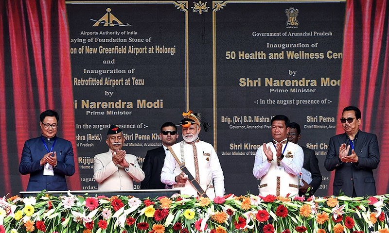 This handout photograph released by India's Press Information Bureau (PIB) on February 9, 2019 shows Indian Prime Minister Narendra Modi (C) inaugurating development projects in Itanagar in northeastern Arunachal Pradesh state. — AFP
