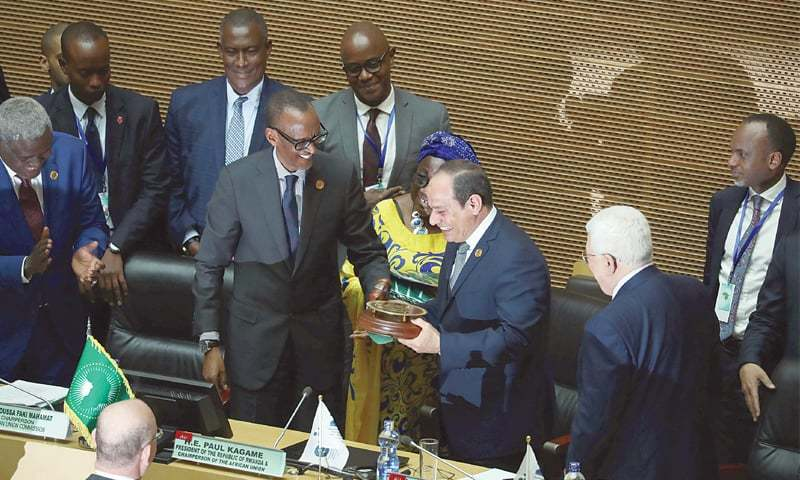 Addis Ababa (Ethiopia): Egyptian President Abdel Fattah al-Sisi (second right) receives the chairmanship of the African Union from Rwandan President Paul Kagame (centre) on Sunday.—Reuters