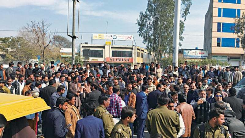 GUJRAT: Medical and business fraternities protest in front of the Federal Board of Revenue offices against raids by the tax collecting agency on some private hospitals, factories and other businesses. — Dawn