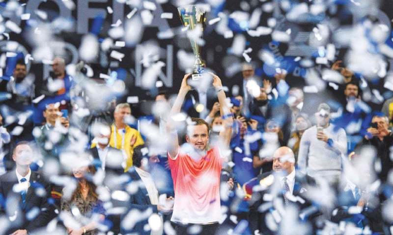SOFIA: Russia's Daniil Medvedev celebrates with the trophy after winning the Sofia Open final against Marton Fucsovics of Hungary.—AFP