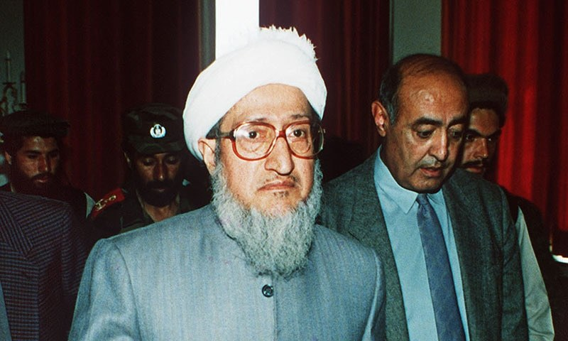 In this April 29, 1992, file photo, then Afghan President Sibghatullah Mujadidi leaves the Foreign Ministry in Kabul, Afghanistan, after briefing foreign diplomats on his first full day in power. — AP