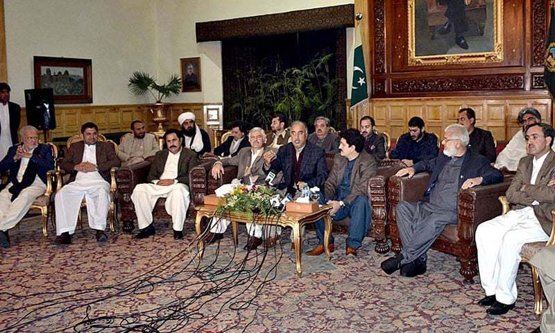 KP Governor Shah Farman and KP Chief Minister Mahmood Khan address a press conference along with senators and MNAs of tribal districts at Governor House in Peshawar. — APP