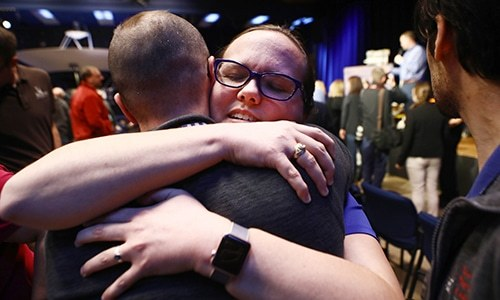 PASADENA, CALIFORNIA - FEBRUARY 13: Keri Bean, NASA Tactical Uplink Lead for the rover Opportunity, hugs a colleague at a press conference announcing the conclusion of the Opportunity mission on February 13, 2019 in Pasadena, California. After 15 years, the Mars rover has finally stopped responding following an immense dust storm on the planet.   Mario Tama/Getty Images/AFP == FOR NEWSPAPERS, INTERNET, TELCOS & TELEVISION USE ONLY ==