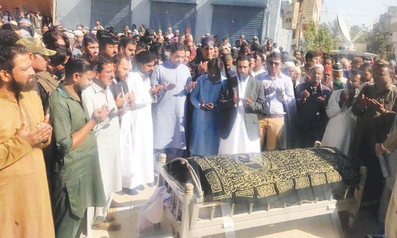 MOURNERS attend the funeral of PTI worker Shafqat in Orangi Town on Friday. — PPI