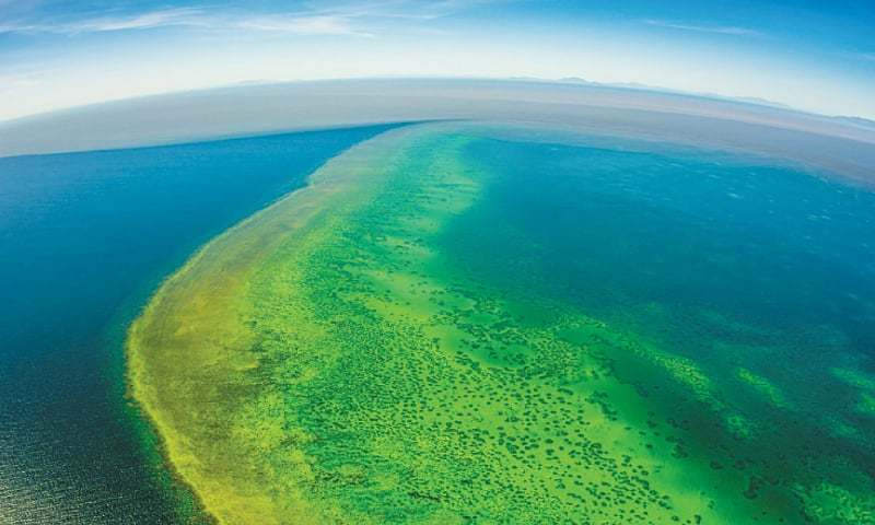 Sediment (top) approaching Australia's Great Barrier Reef from recent unprecedented rain and flooding around Cape Cleveland, off Townsville.—AFP