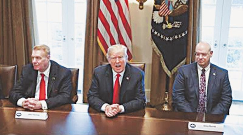 Washington: In this March 1, 2018 photo, President Donald Trump speaks during a meeting with steel and aluminum executives in the Cabinet Room of the White House, with Nucor's John Ferriola, left, and Dave Burritt of US Steel Corporation.—AP