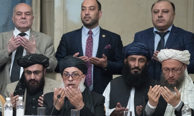 "Taliban political chief Sher Mohammad Abbas Stanikzai, first row second from left, Abdul Salam Hanafi and other Taliban official pray during the ""intra-Afghan"" talks in Moscow on Feb. 6, 2019. ─ AP"