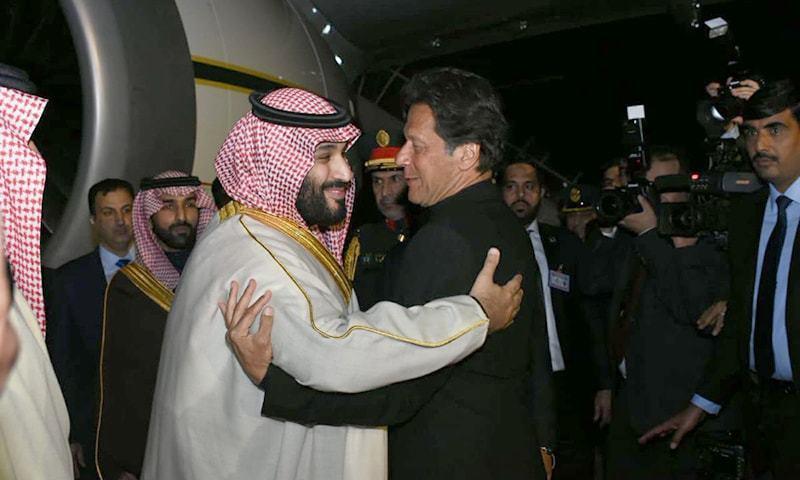 Prime Minister Imran Khan greets Saudi Crown Prince Mohammad bin Salman upon his arrival at Nur Khan Air Base. — Photo courtesy: Arab News