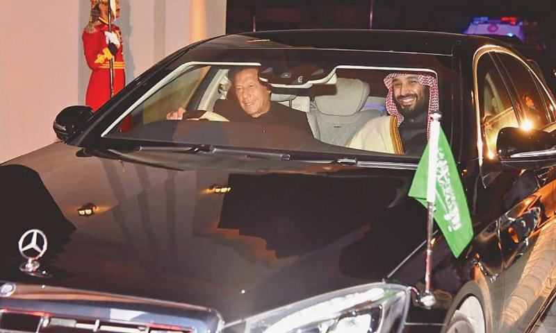PRIME Minister Imran Khan drives Saudi Crown Prince Mohammad bin Salman to the PM House from Nur Khan Air Base on Sunday.—White Star