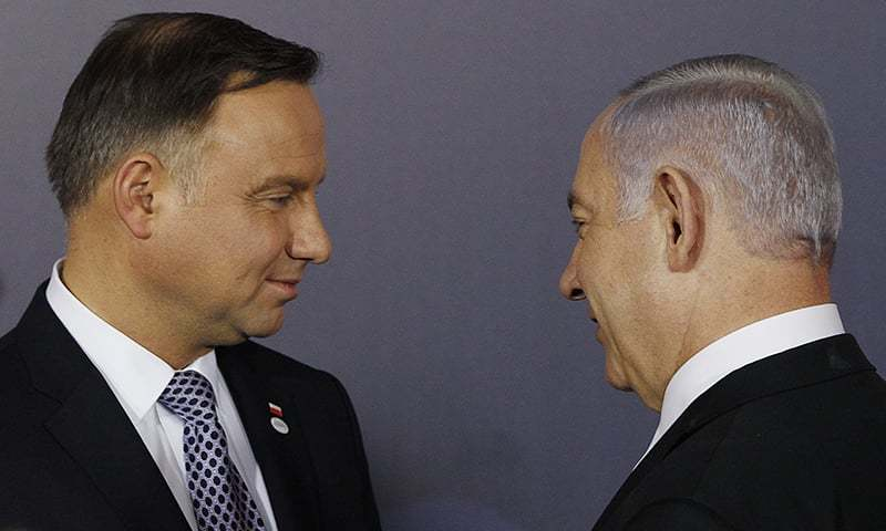 In this file photo, Polish President Andrzej Duda, left, and Israeli Prime Minister Benjamin Netanyahu, talk after a group photo during a two-day international conference on the Middle East, at the Royal Castle in Warsaw, Poland. — AP