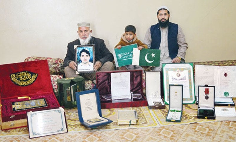 Farman Ali Khan's father Umar Rehman displays the King Abdul Aziz Medal of the First Order which he was awarded posthumously. — Photo courtesy Arab News