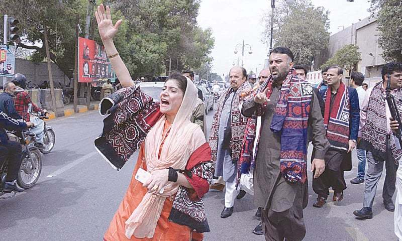 PTI lawmakers and activists protest outside CM House on Tuesday.—Online