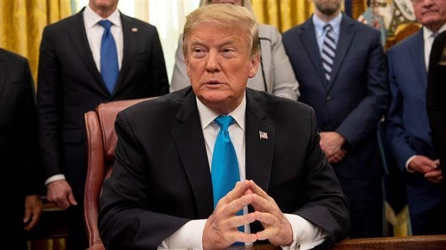 "President Donald Trump pauses during a signing event for ""Space Policy Directive 4"" in the Oval Office of the White House on Tuesday. — AFP"