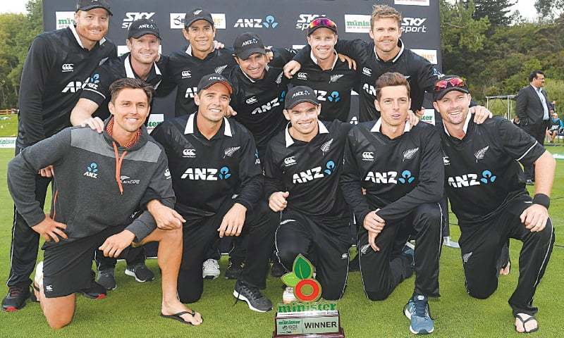 DUNEDIN: New Zealand cricketers pose with the trophy as they celebrate their series triumph following the third One-day International against Bangladesh at the University Oval on Wednesday.—AFP
