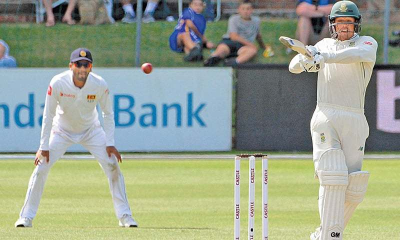 PORT ELIZABETH: South African batsman Quinton de Kock plays a shot during the second Test against Sri Lanka at the St George's Park on Thursday.—AFP