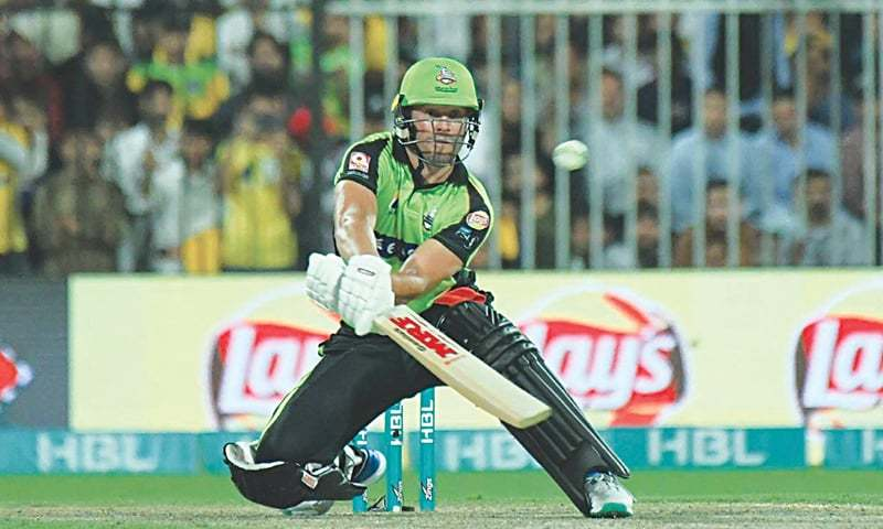 SHARJAH: Lahore Qalandars' captain A.B. de Villiers hits a six in an unorthodox fashion during the PSL match against Multan Sultans on Friday.—courtesy PCB