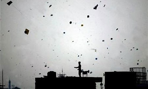A woman and a five-year-old girl were killed during firing in the air and more than 140 people were injured in the garrison city on Friday as people celebrated basant despite the ban on kite flying. — Reuters