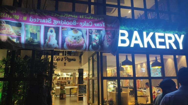 """Some people had gathered at the Indiranagar outlet of Karachi Bakery on Friday evening to demand that it pull down its signboard. Subsequently, photos showing the word """"Karachi"""" covered up on the signboard and an Indian flag displayed at the bakery started making rounds on social media. ─ Photo courtesy Twitter"""