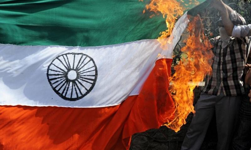 Businessmen civil society organisations hold demonstration set on fire the Indian flag and effigy of Modi.— AFP  File
