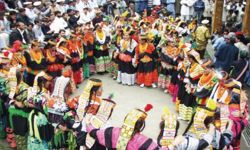 Kalash women busy in merrymaking during a festival in Bumburate valley. ? File photo