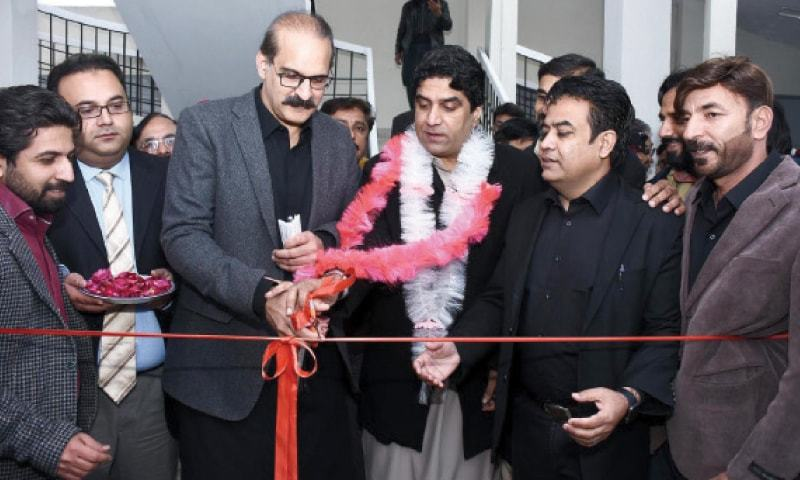 NHS Minister Aamer Mehmood Kiani and Special Assistant to Prime Minister on CDA Affairs Ali Nawaz Awan inaugurate a model centre in G-7/3 dispensary on Saturday. — INP